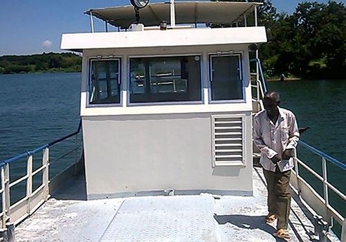 Motorboat Nyasaye Erokamano for the Catholic Mission Mbita at Lake Victoria, East Africa. Picture left: Found material carpentry Bodan shipyard. Joseph Bhwana Collection, Musoma/Tanzania.